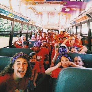 A bus filled with exuberant Day campers and counselors, on their way to another exciting field trip