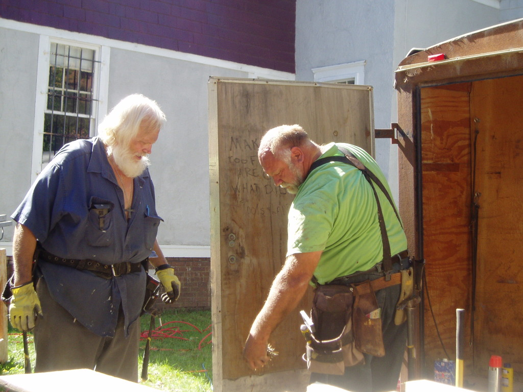 Two older gentlemen building at Carriage Town Ministries