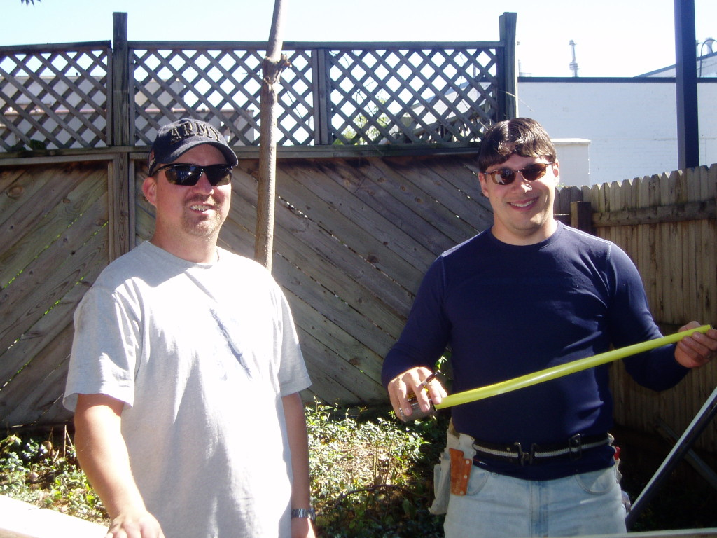 Two smiling middle-aged guys working at Carriage Town Ministries.